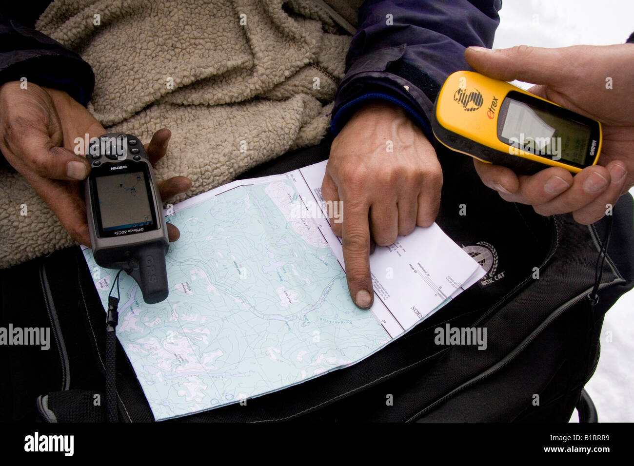 Navigation using a Garmin GPS device and a map - Stock Image