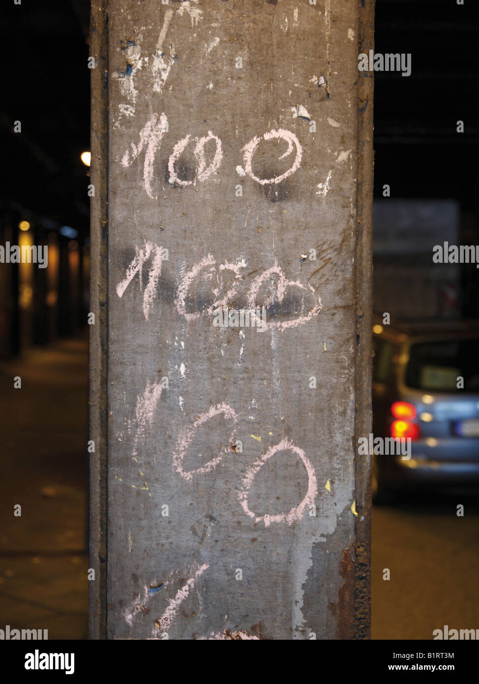Number one hundred written on column 100 - Stock Image