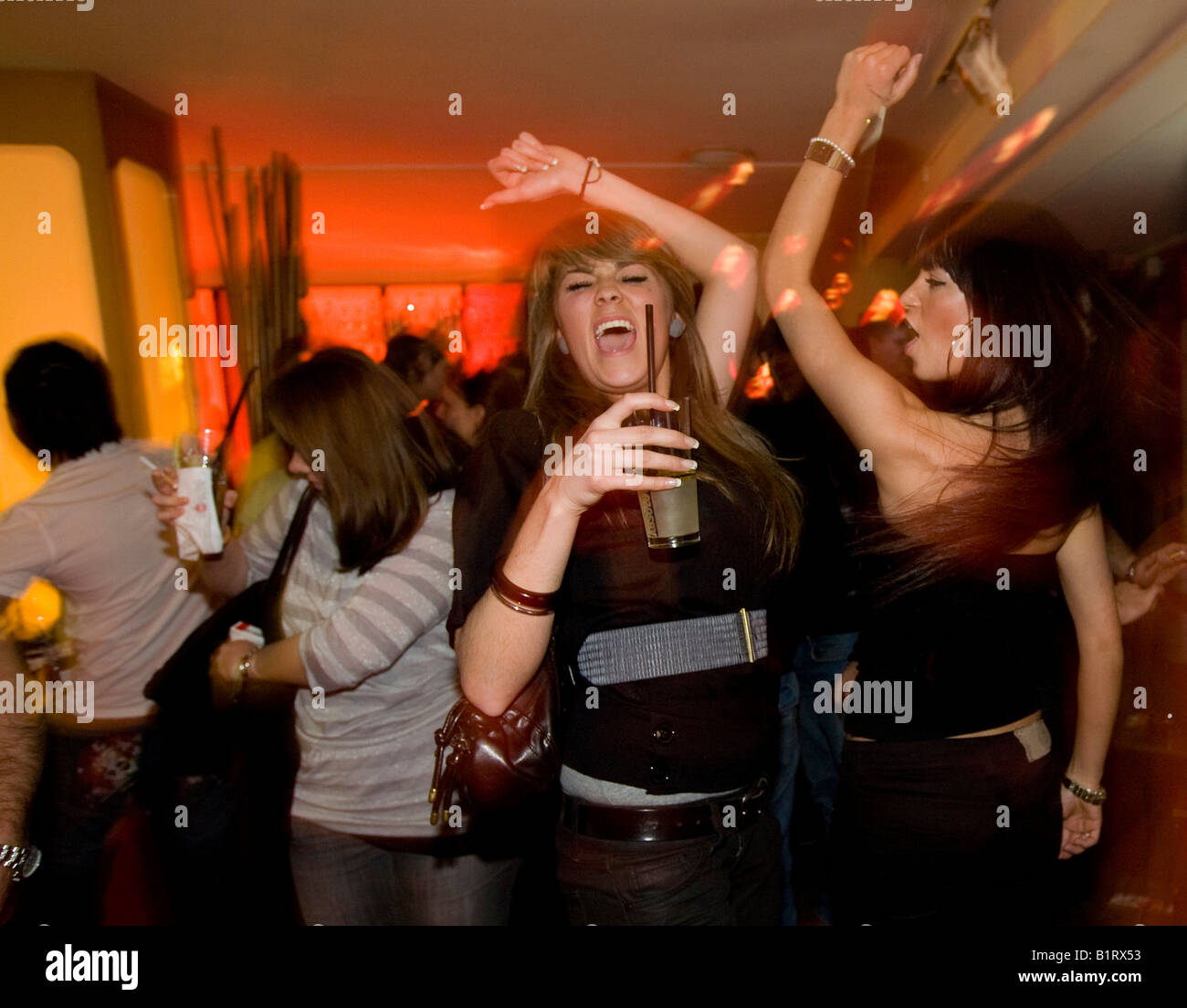 People partying in the China Lounge in the Reeperbahn red-light district, Nobistor, Sankt Pauli, Hamburg, Germany - Stock Image