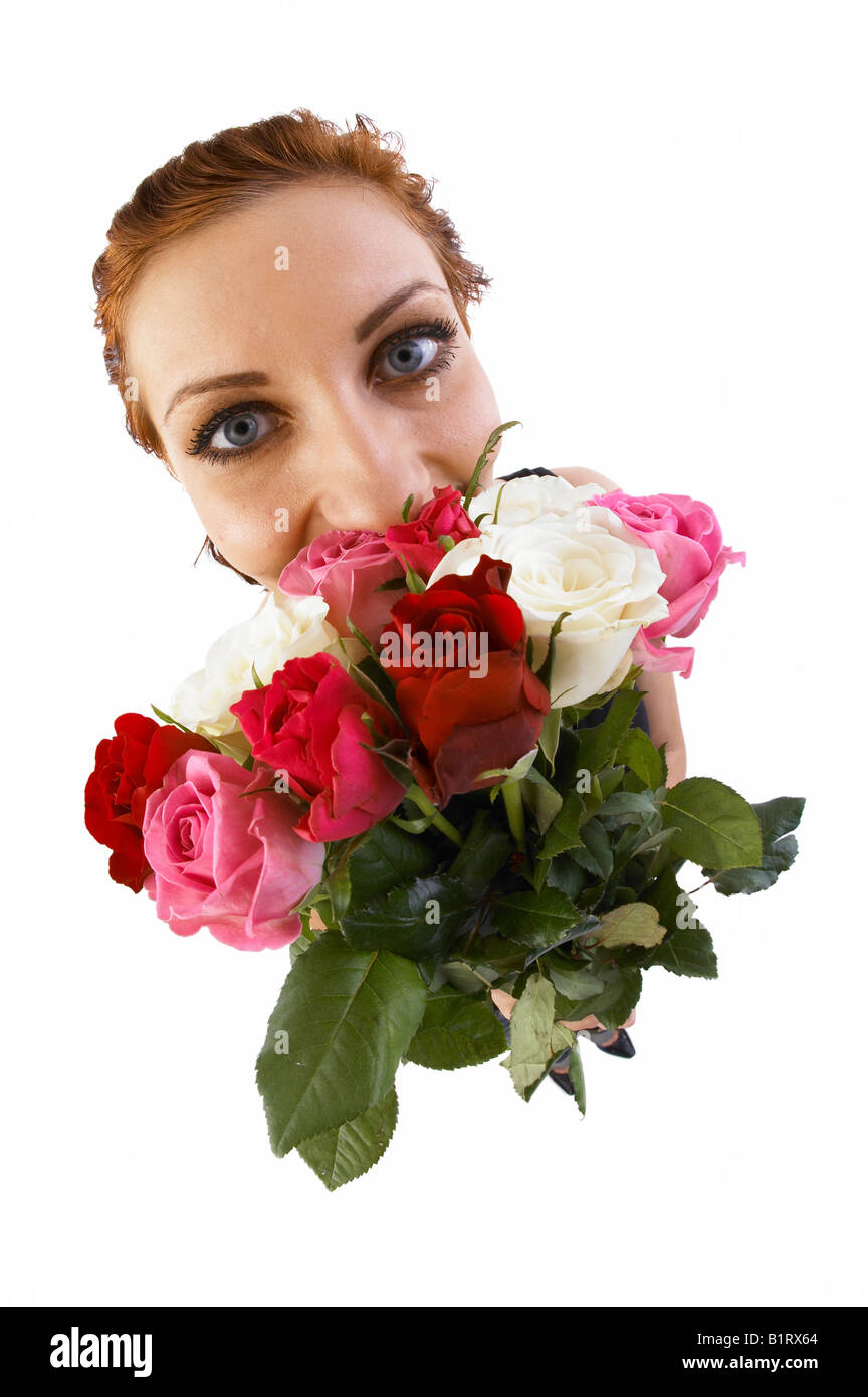 Woman holding a bouquet of flowers, fish-eye lens - Stock Image