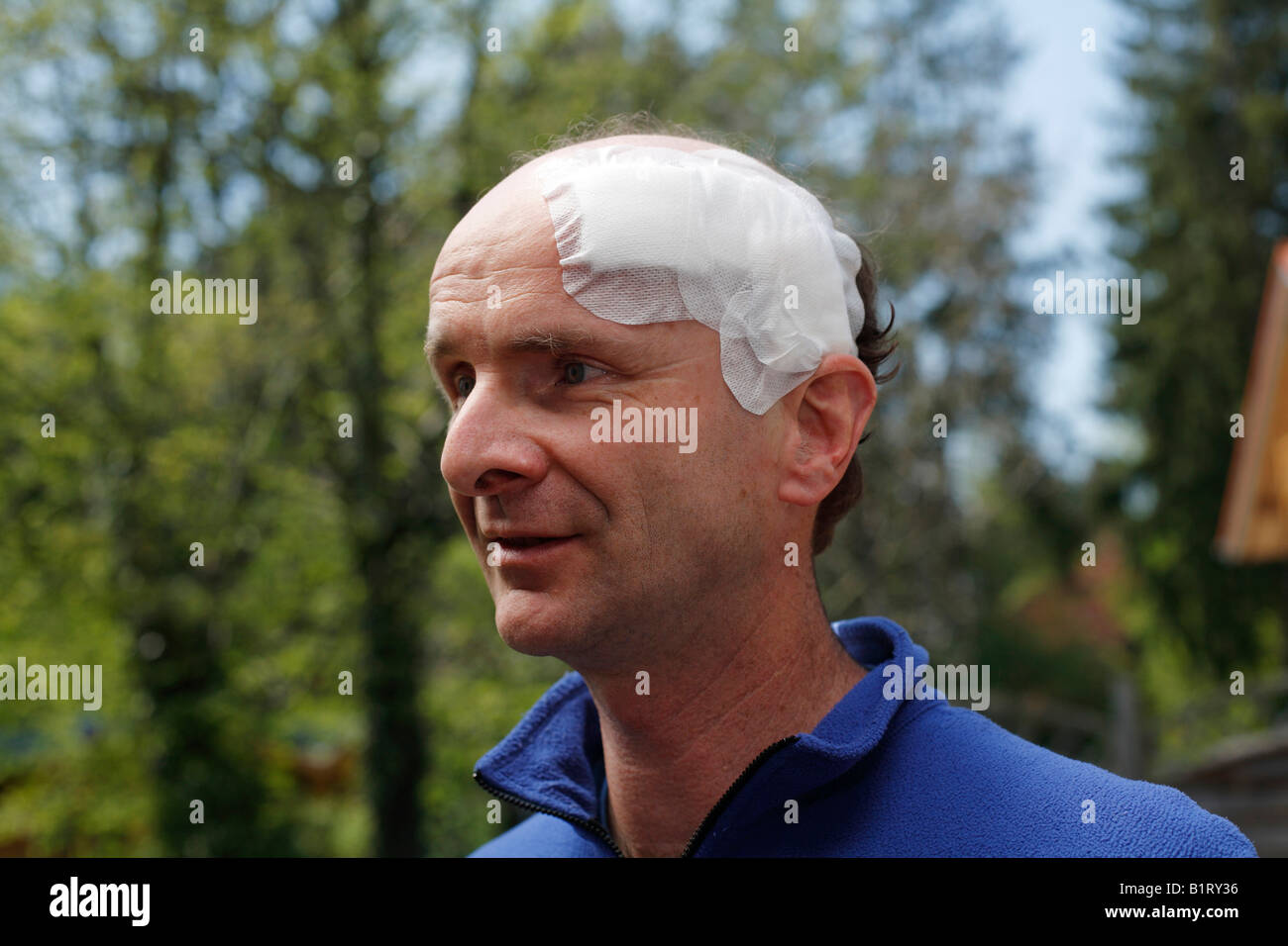Portrait of a man, 45, with an adhesive bandage on his head, Geretsried, Bavaria, Germany, Europe Stock Photo