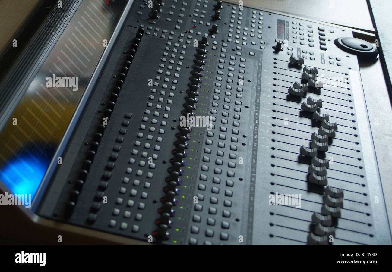Sliding controls, turning controls and buttons of a professional mixer unit - Stock Image