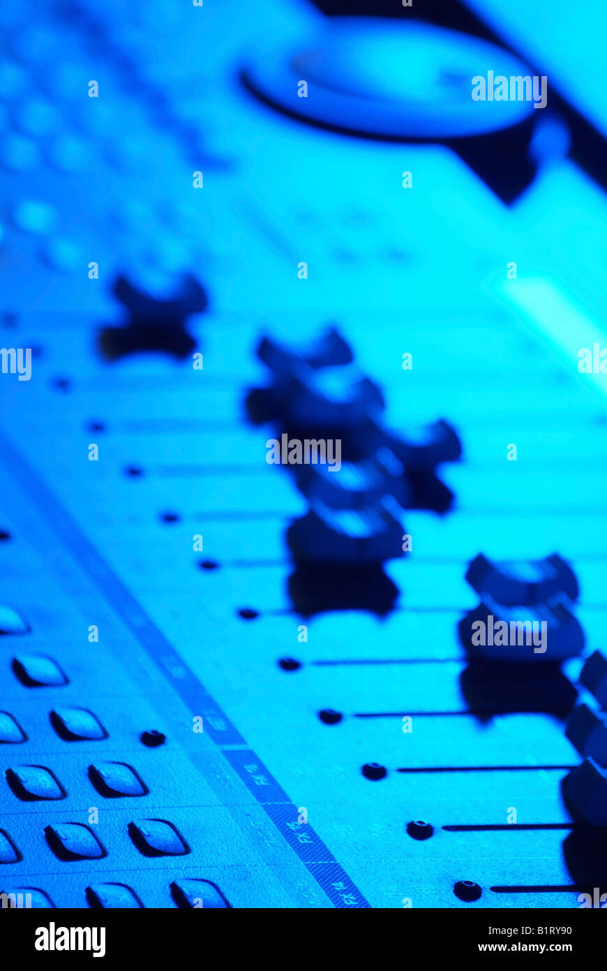 Slide controls, scroll bars, faders, professional mixing console, mixing desk, soundboard - Stock Image