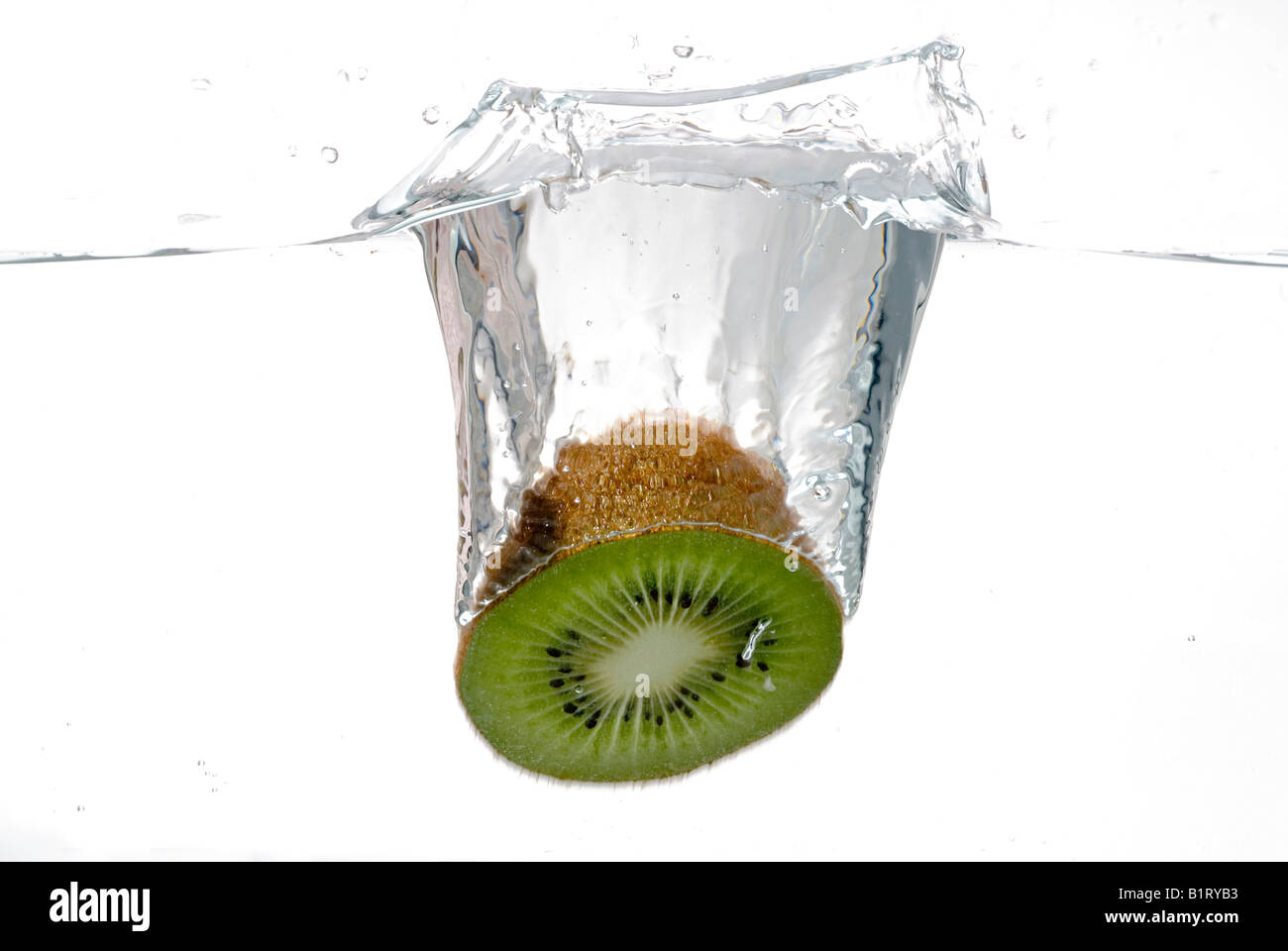 Half a kiwi plunging into water - Stock Image