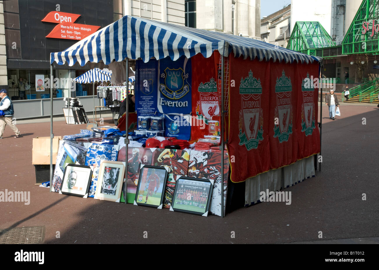 Market stall selling football merchandise Liverpool city centre - Stock Image