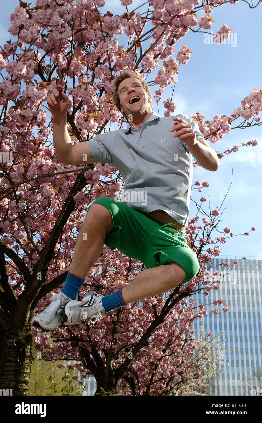 33 year-old man jumping in the city in spring Stock Photo