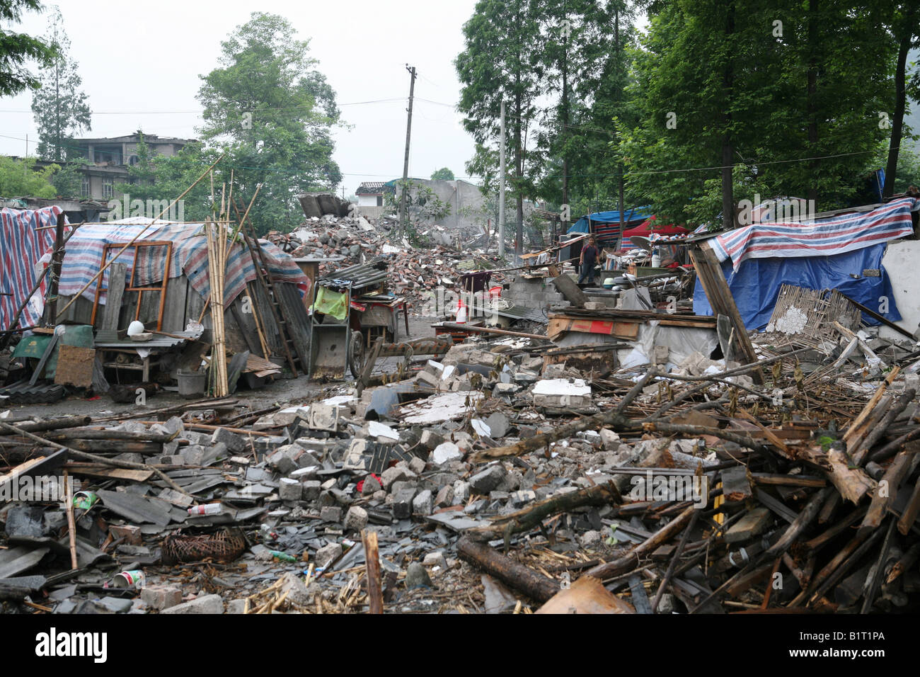 Devastated houses lie in ruins in Pengzhou, following the Sichuan Earthquake of 12th May 2008, China - Stock Image