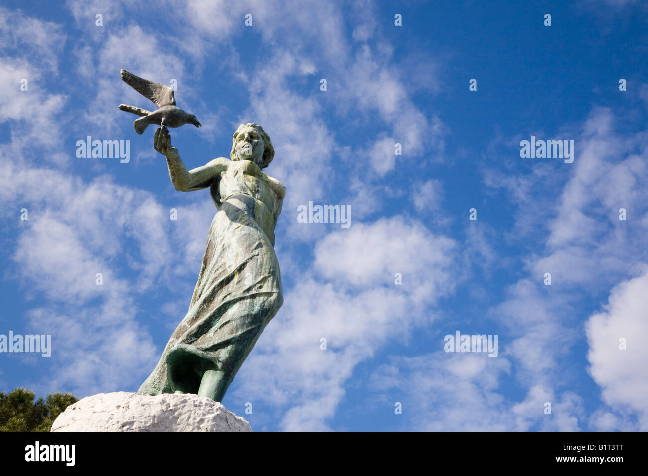 Opatija Istria Croatia Europe Maiden with the seagull statue on rock front view against blue sky - Stock Image