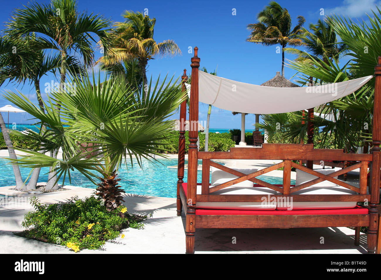 relaxing at Grace Bay Club - Stock Image