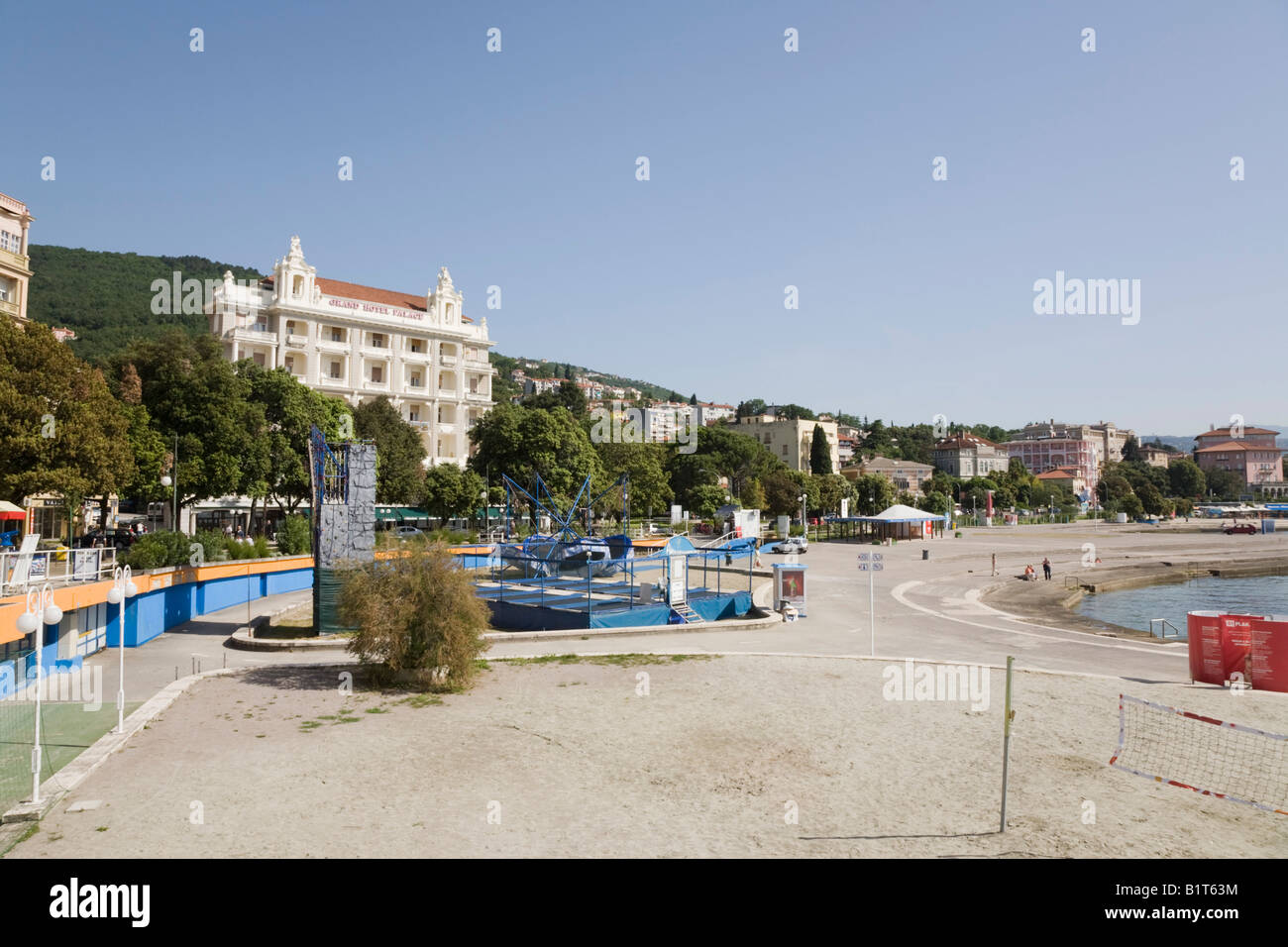 Opatija Istria Croatia Europe May Man-made concrete beach on seafront in tourist seaside resort on Kvarner coast - Stock Image