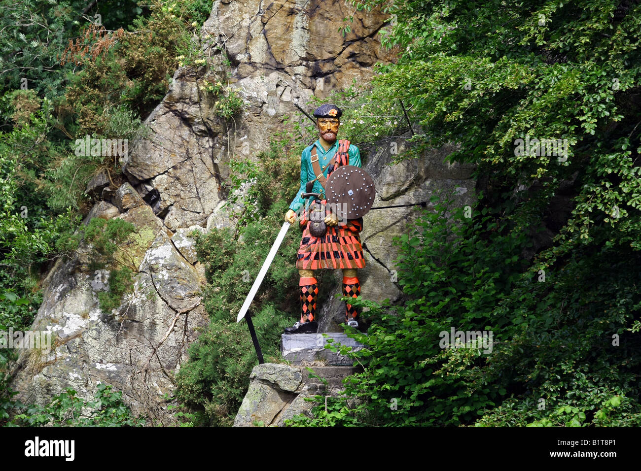 Statue of Scottish character Rob Roy McGregor over the Culter Burn at Peterculter, Aberdeenshire, Scotland, UK Stock Photo