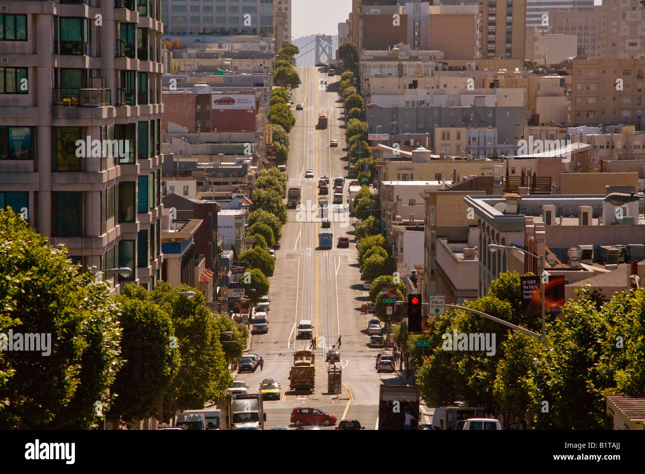Cable cars share the steep Eastbound slope of San Francisco s California Street with regular traffic - Stock Image