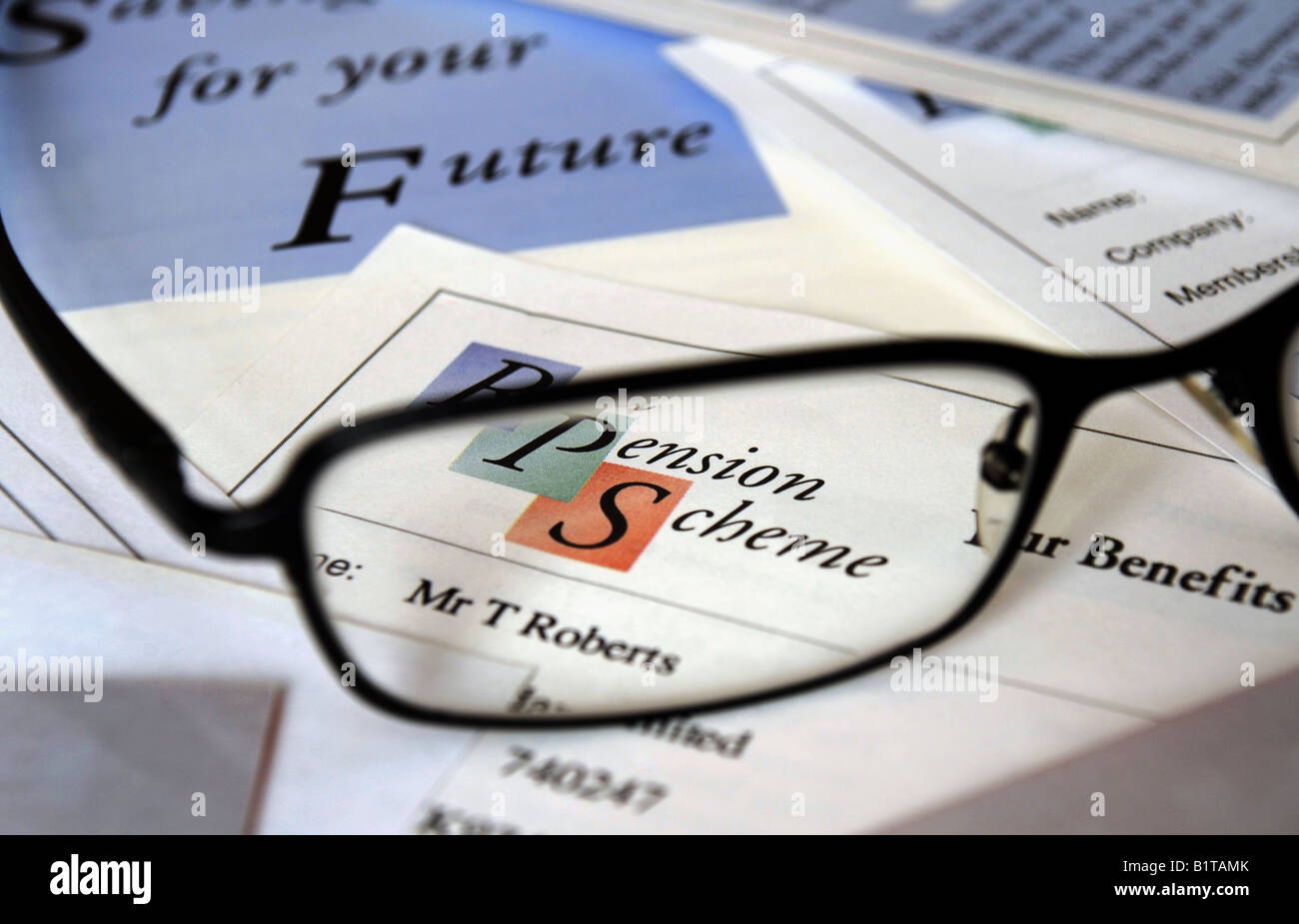 BRITISH COMPANY PENSION SCHEME DOCUMENTS WITH SPECTACLES,UK. - Stock Image