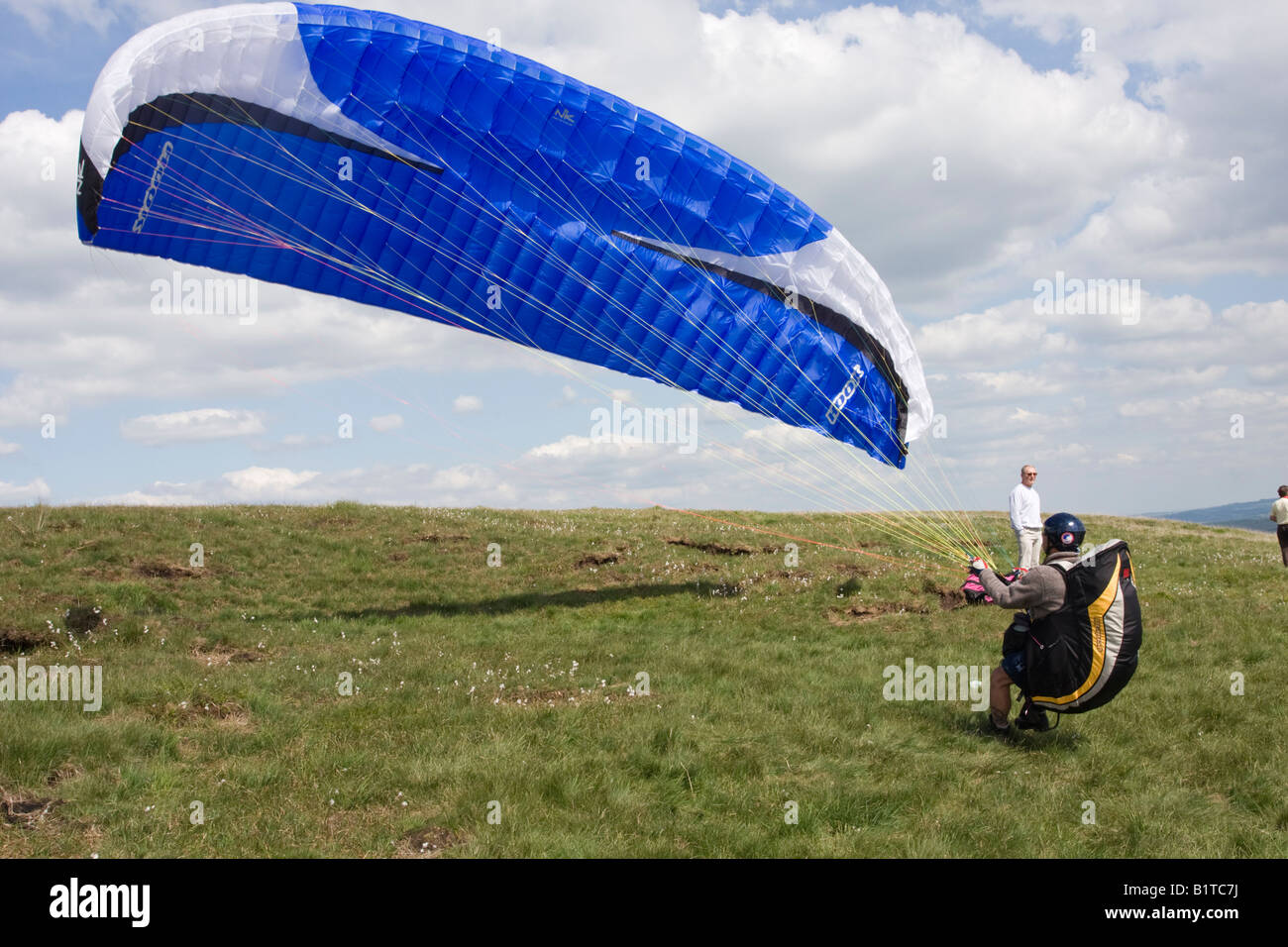 wind fills the Para Glider Canopy Ready to take off from Buckstones Edge - Stock Image