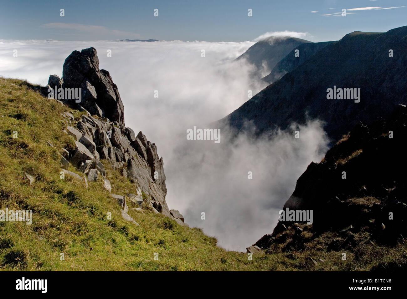 North Face of Cadair Idris above cloud during temperature inversion Stock Photo