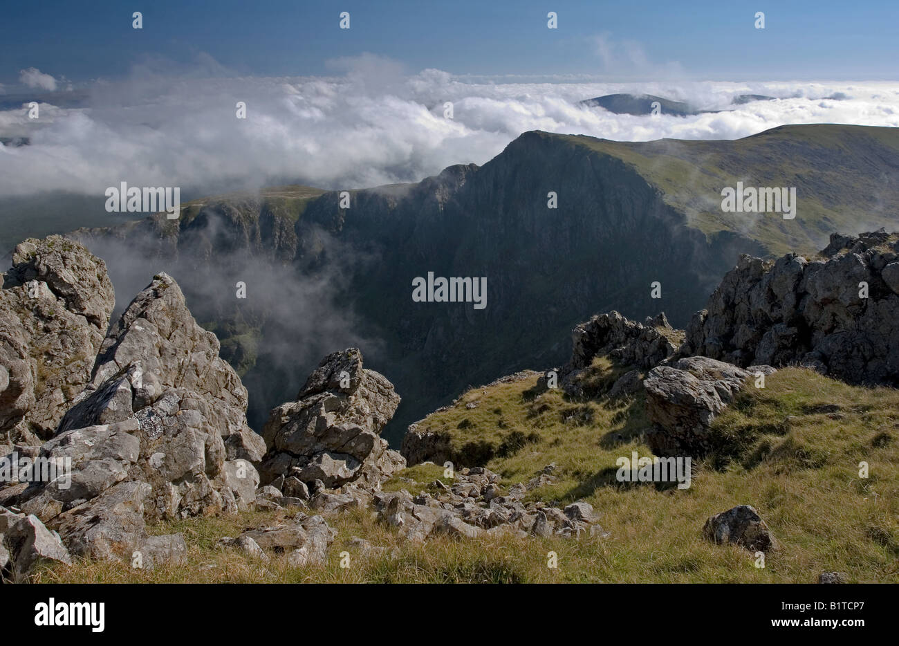 Cadair Idris in temperature inversion with Craig Cau in the middle distance Stock Photo