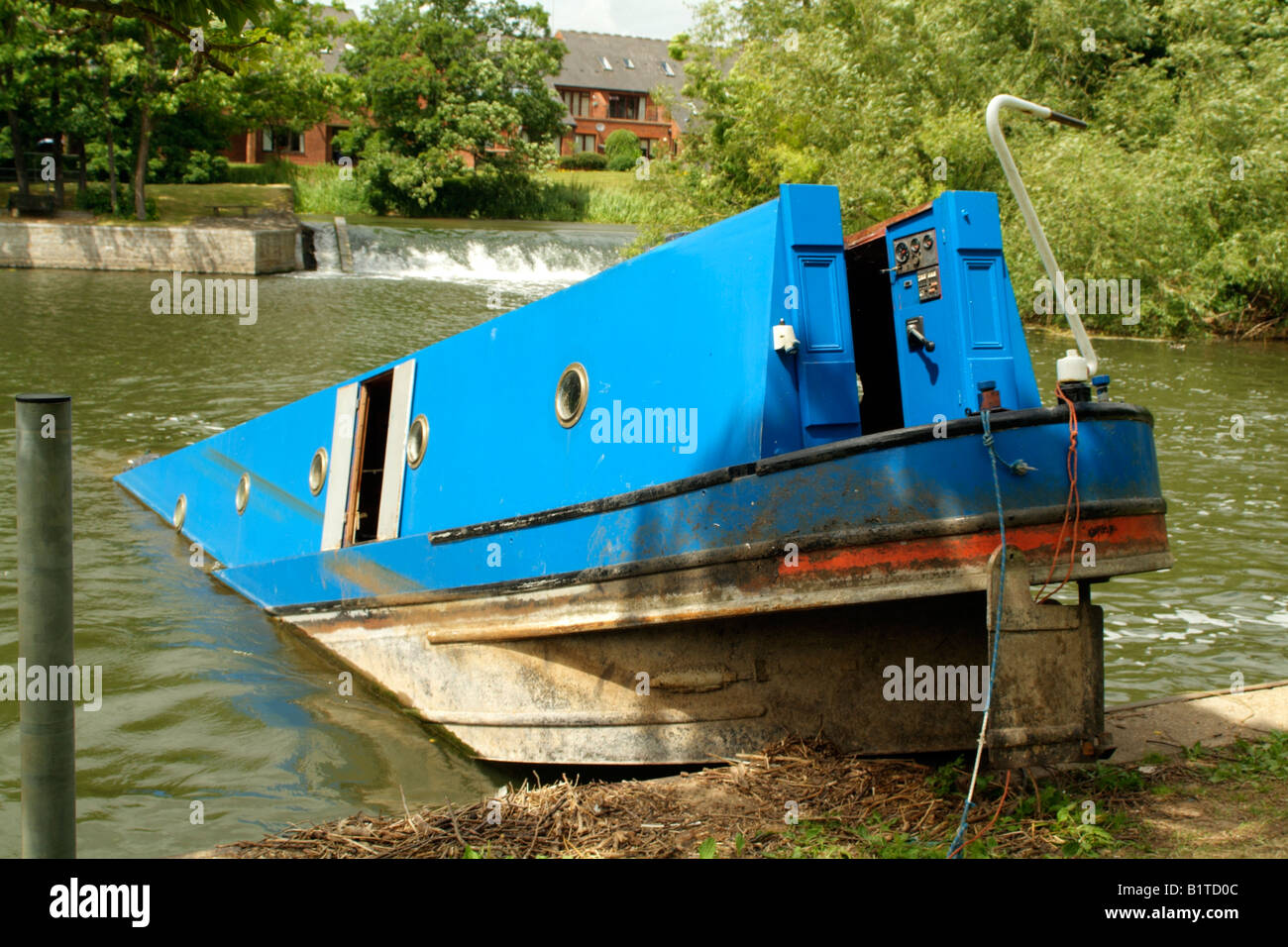 Canalboat sinking into the River Avon at Stratford upon Avon England UK - Stock Image