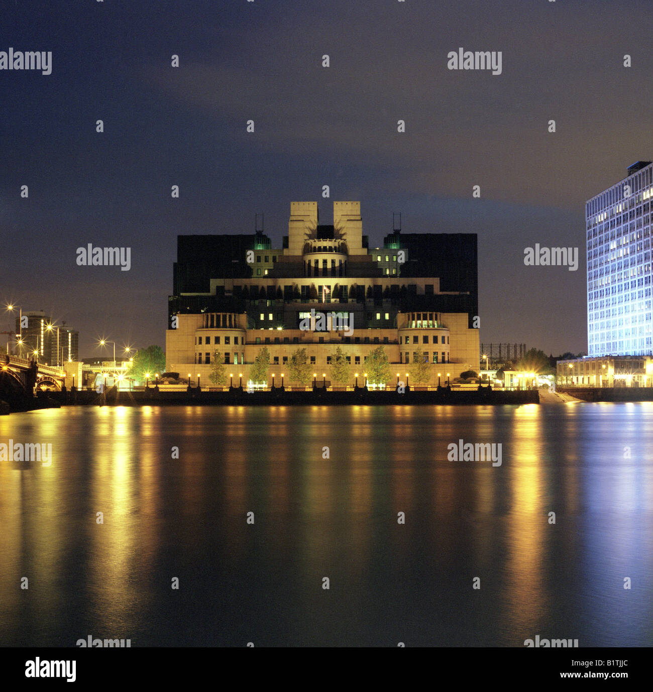 the MI6 building at Vauxhall cross at night - Stock Image