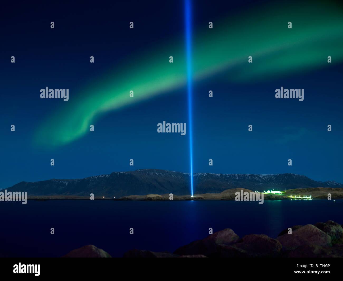 Aurora Borealis with  the Imagine Peace Tower, Videy Island Reykjavik Iceland Stock Photo