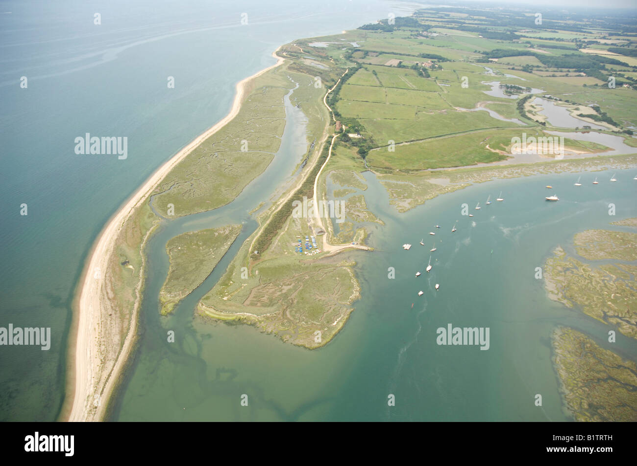 Aerial View of Needs Ore at the mouth of the Beaulieu River, where it meets the Solent in Hampshire, England. - Stock Image