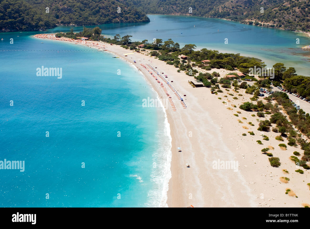 Arial view of Oludeniz beach in Fethiye, Mugla Turkey from a paraglider who jumped off babadag mountain - Stock Image