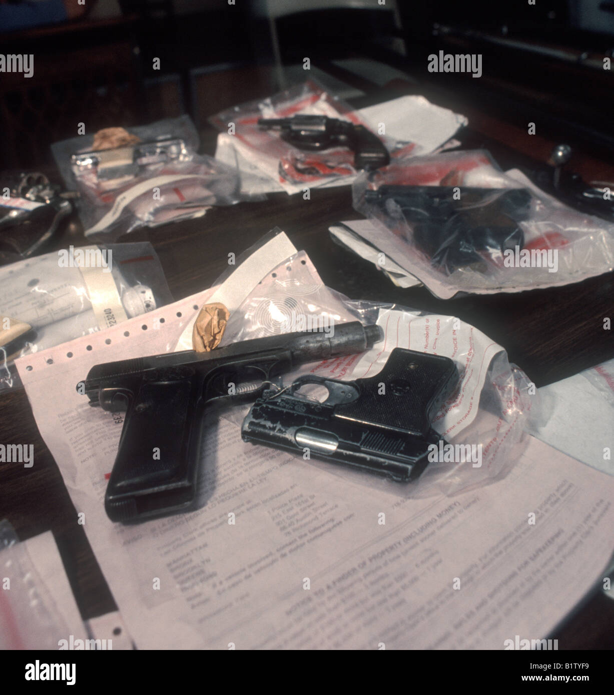 A collection of guns confiscated by the NYPD in New York - Stock Image