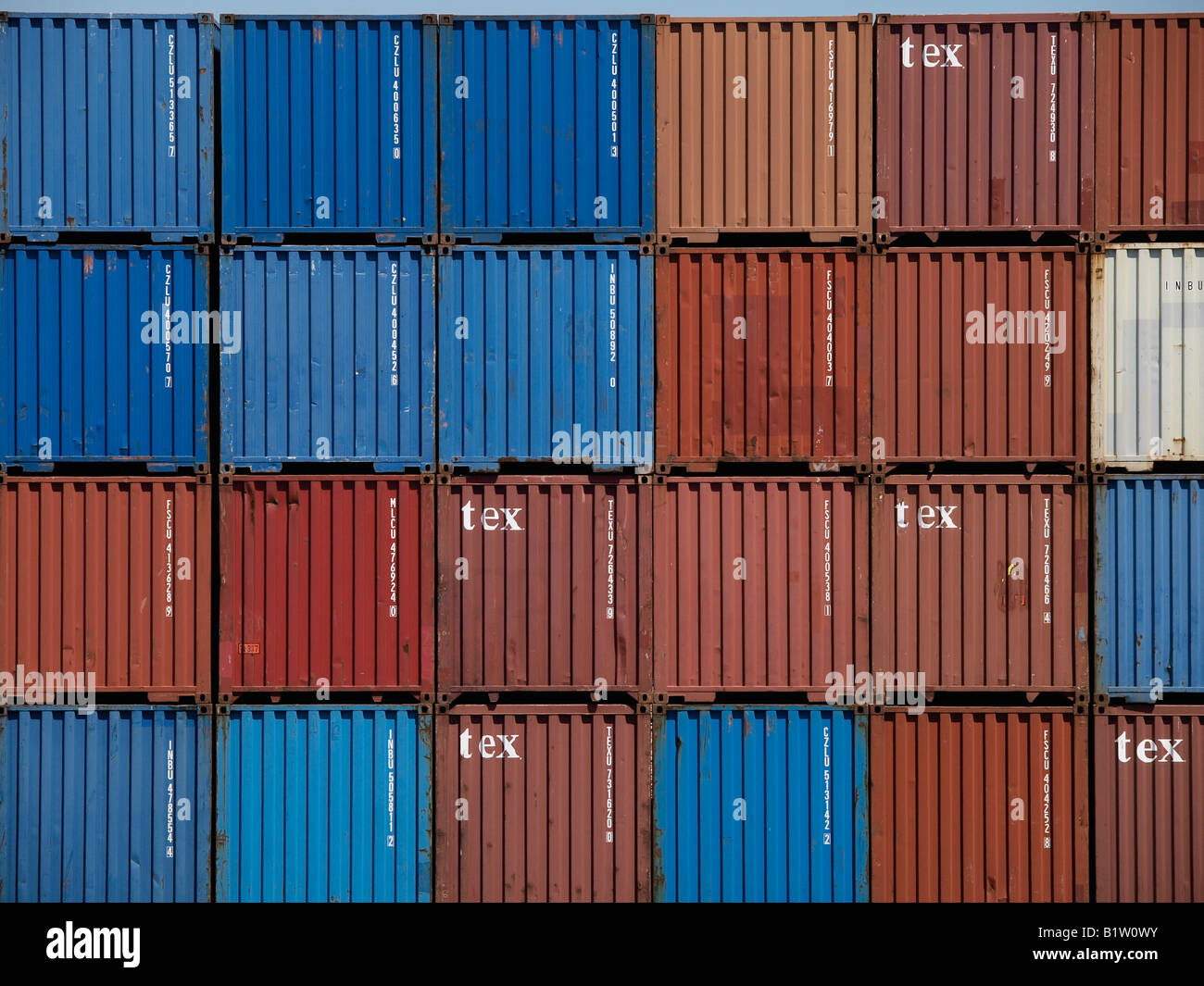 shipping sea containers tex pattern blue and red port of Antwerp Flanders Belgium - Stock Image