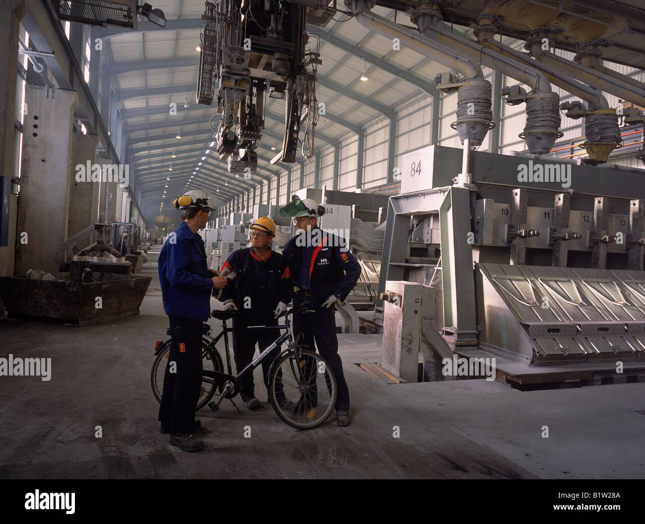 Workers with Bicycle in Nordural Aluminum Factory, Iceland - Stock Image
