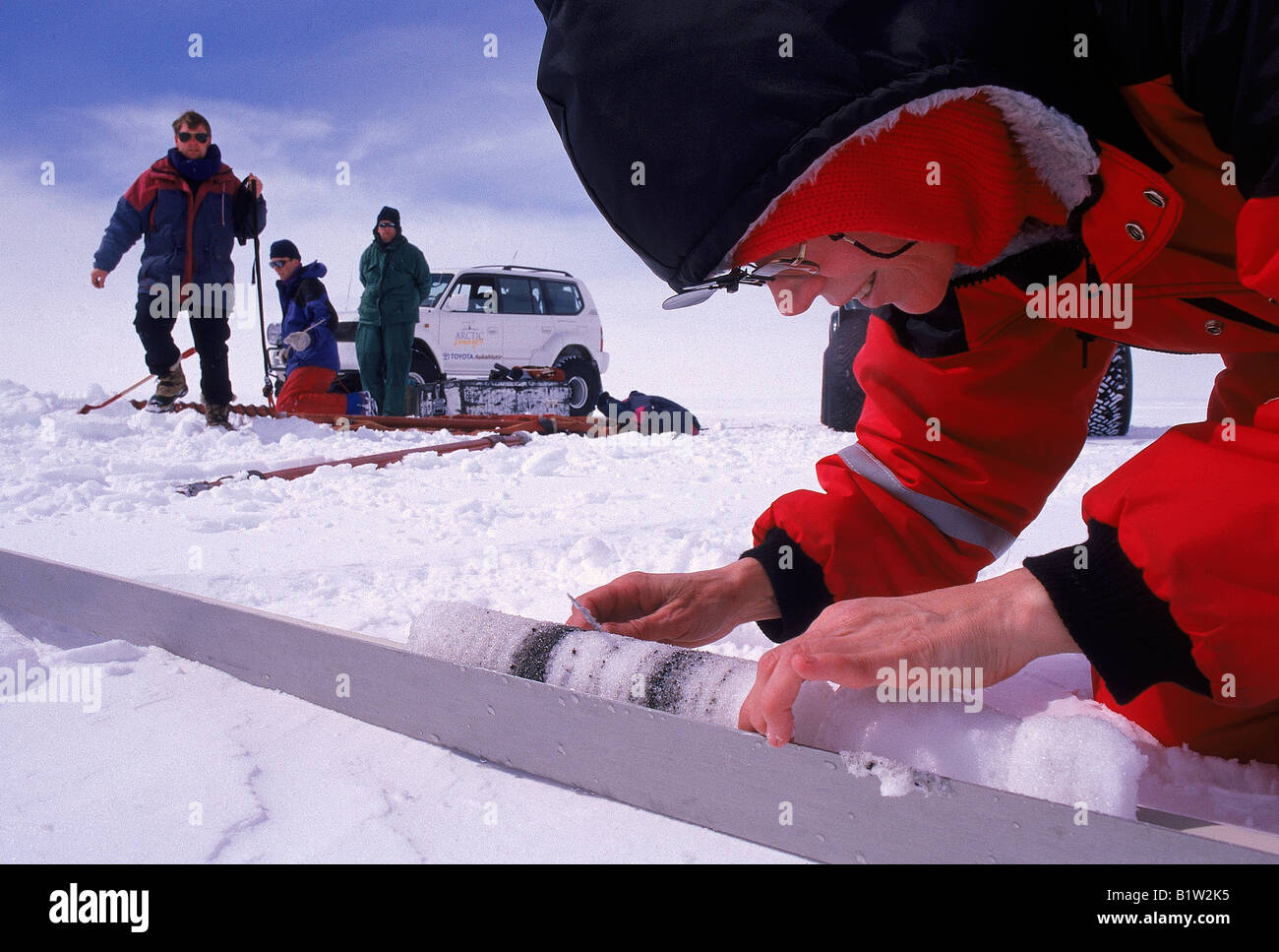 Research Scientist Examining an Ice Core - Stock Image