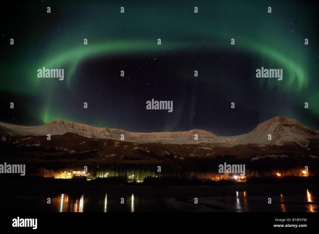 Aurora Borealis or Northern Lights over Mount Esja, Reykjavik Iceland - Stock Image