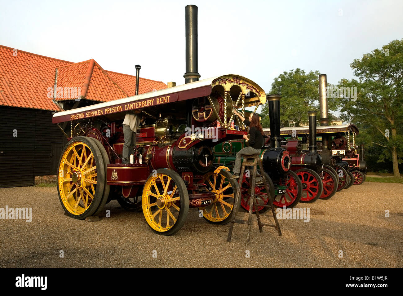 Rw of Traction Engines being cleaned and prepared for rally in Preston Kent UK - Stock Image