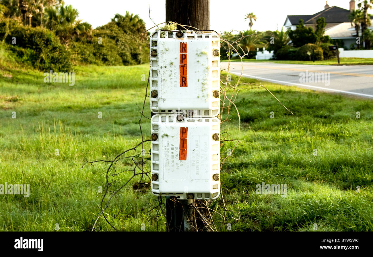 Two power boxes on a telephone pole by the roadside in Ponte Vedra Beach, Florida Stock Photo
