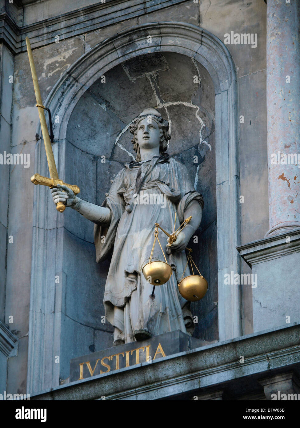 Lady Justice statue iustitia with golden scales of justice and sword Antwerp Flanders Belgium - Stock Image