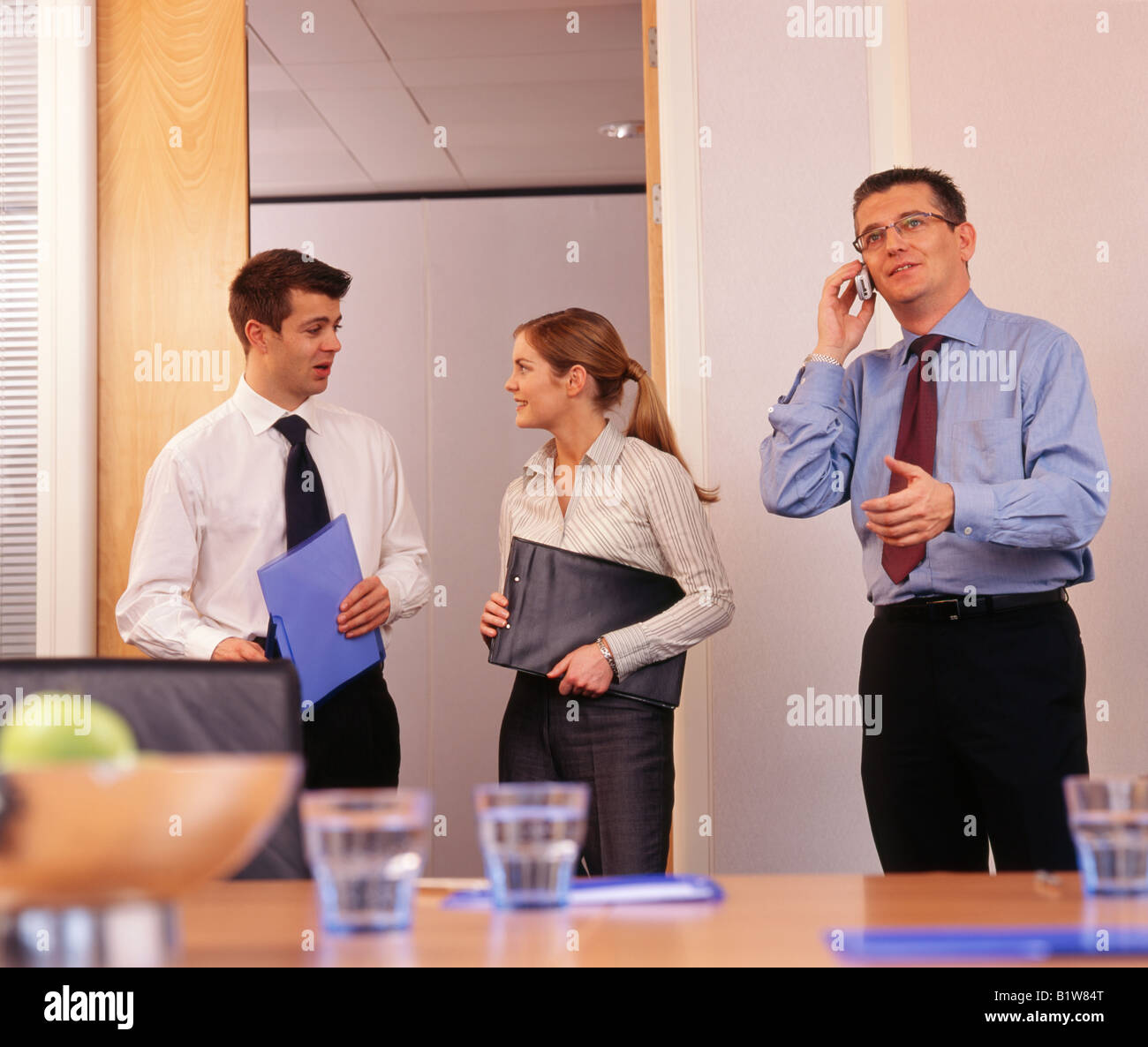 man with mobile phone at business meeting - Stock Image