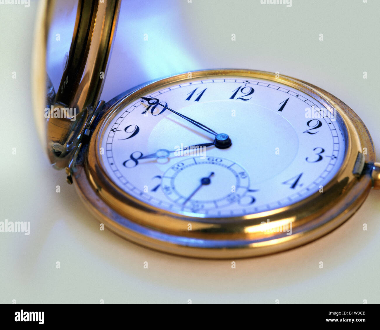 TIME CONCEPT: Golden Pocket Watch - Stock Image