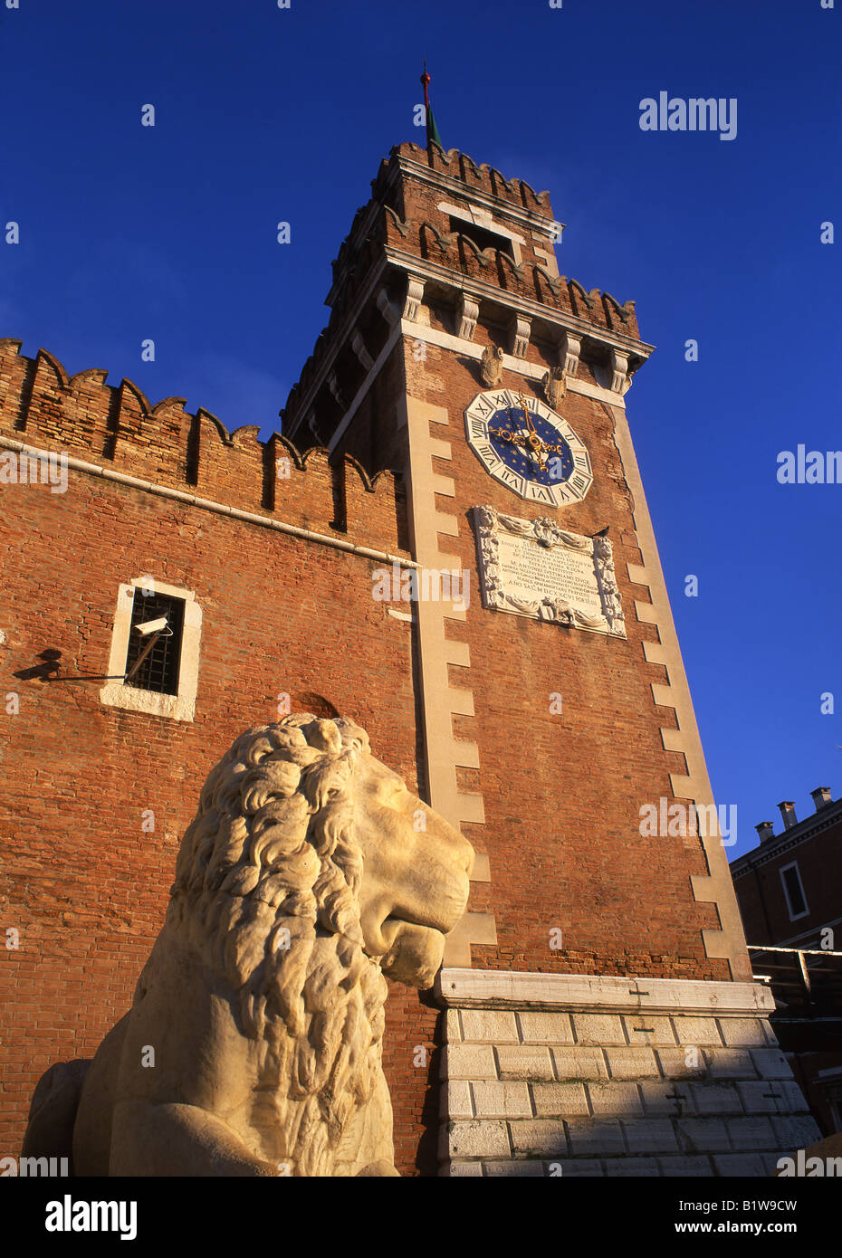 Lion sculpture Arsenale gateway Castello sestier Venice Veneto Italy - Stock Image