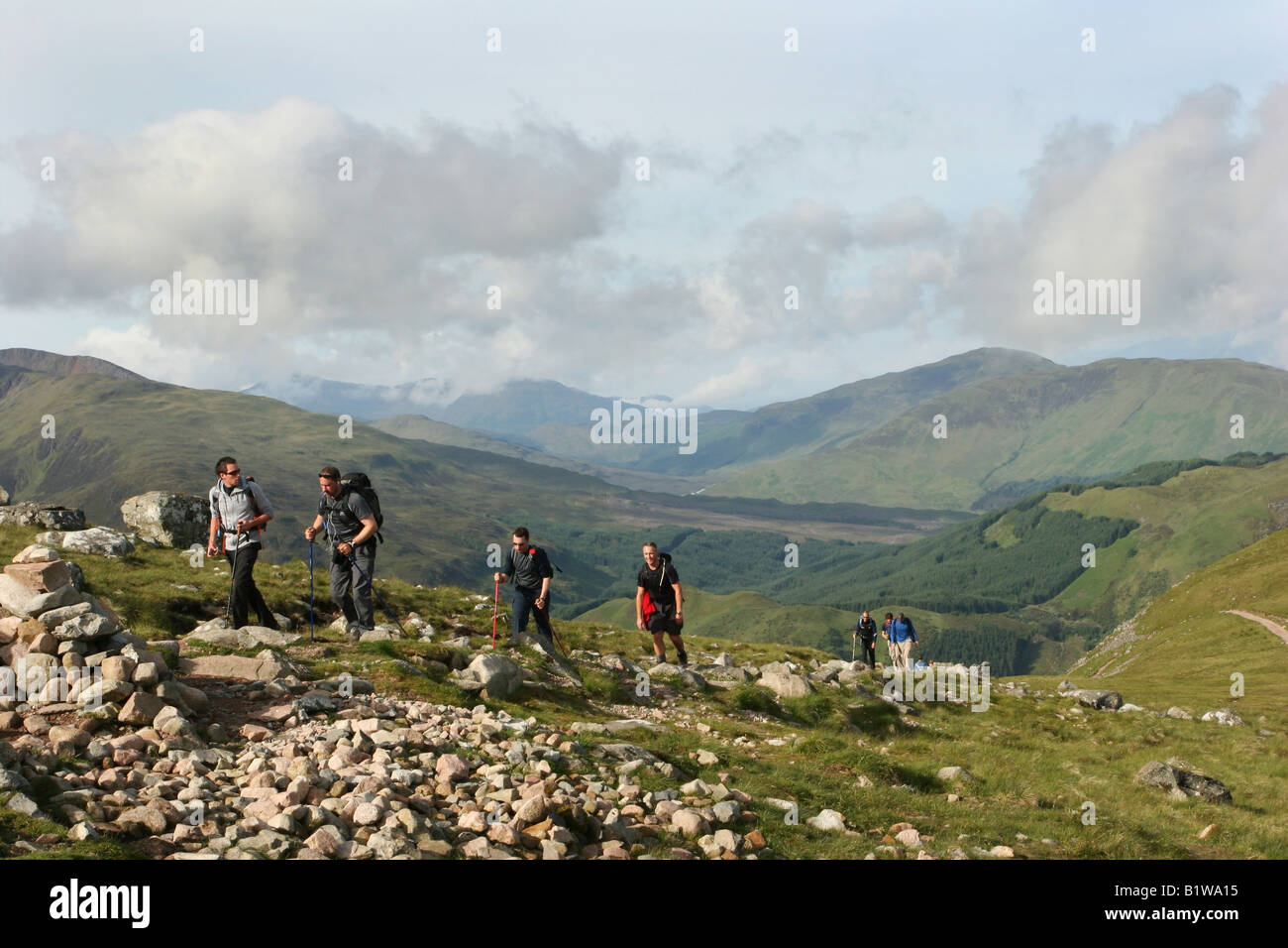 Walkers ascending path to Ben Nevis on The Three Peaks Challange - Stock Image