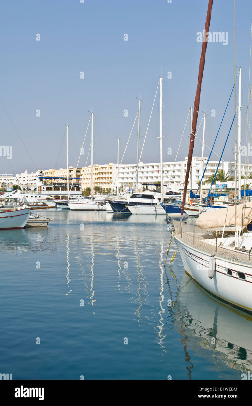 A view of yachts moored in the Yasmine Hammamet marina on a sunny day with blue sky. - Stock Image