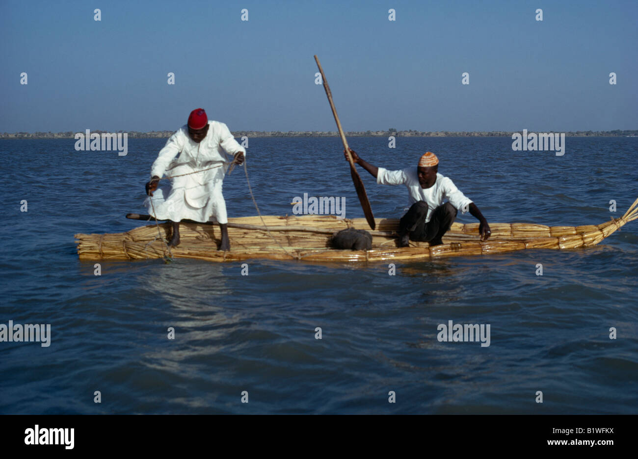 CHAD Central Northern Africa Lake Chad Two Buduma tribesmen fishing in a reed boat - Stock Image