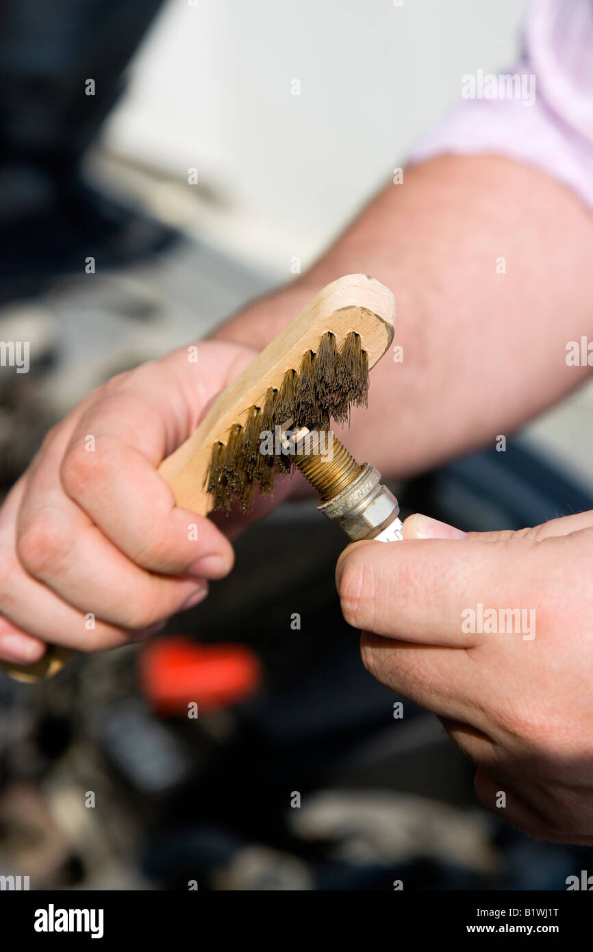 Spark Plug Wire Stock Photos Images Alamy Wiring New Zealand Transport Road Cars Man Cleaning A With Brush Image