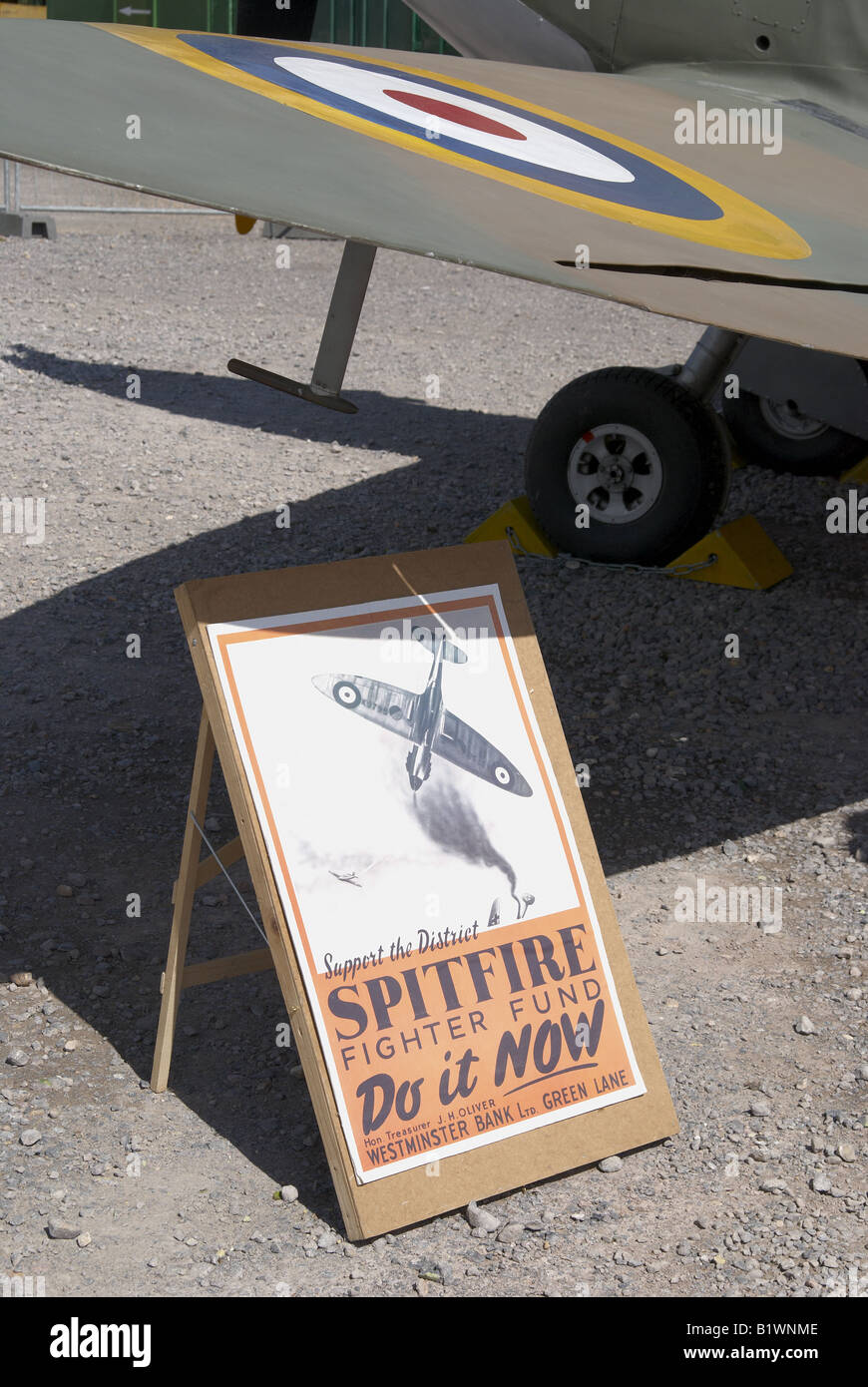 WW2 re-enactment somewhere in southern England just before D-Day - Spitfire Appeal poster and replica plane - Stock Image