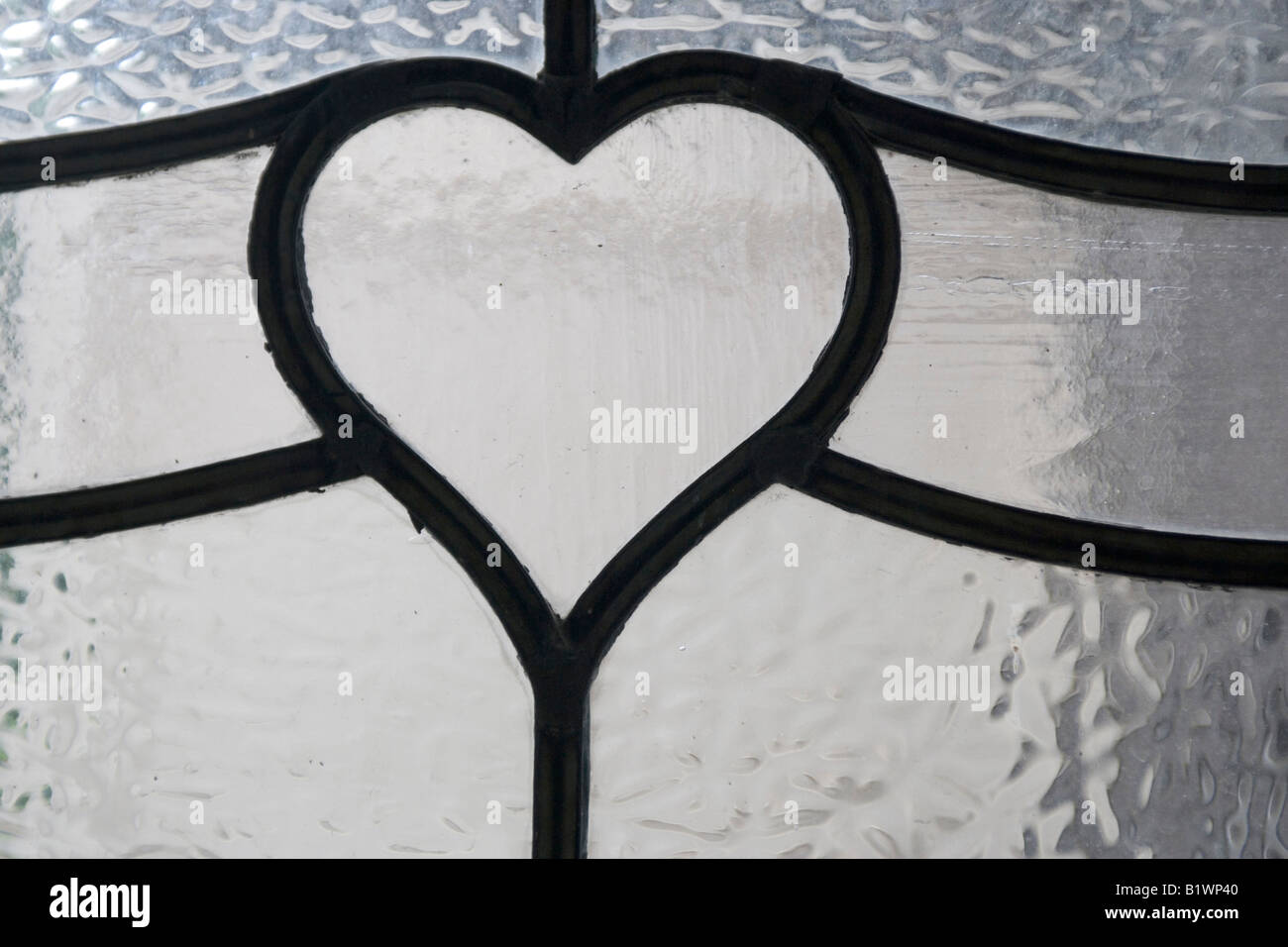 A heart-shaped detail in lead came. - Stock Image