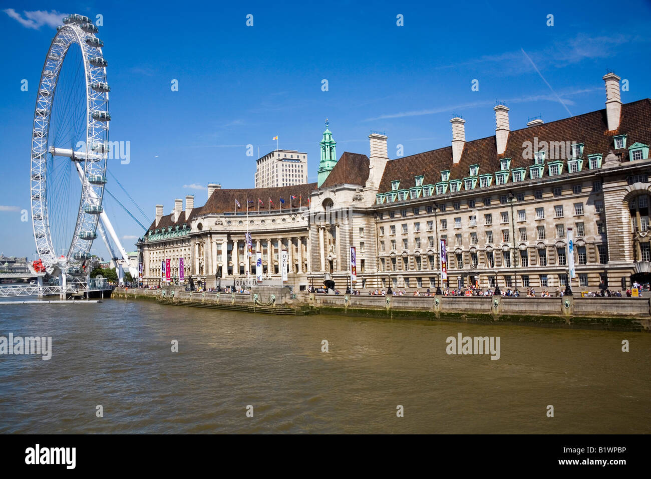 The Old GLC building on the South Bank which now houses the London Aquarium and the Dali Exhibition London Eye on - Stock Image