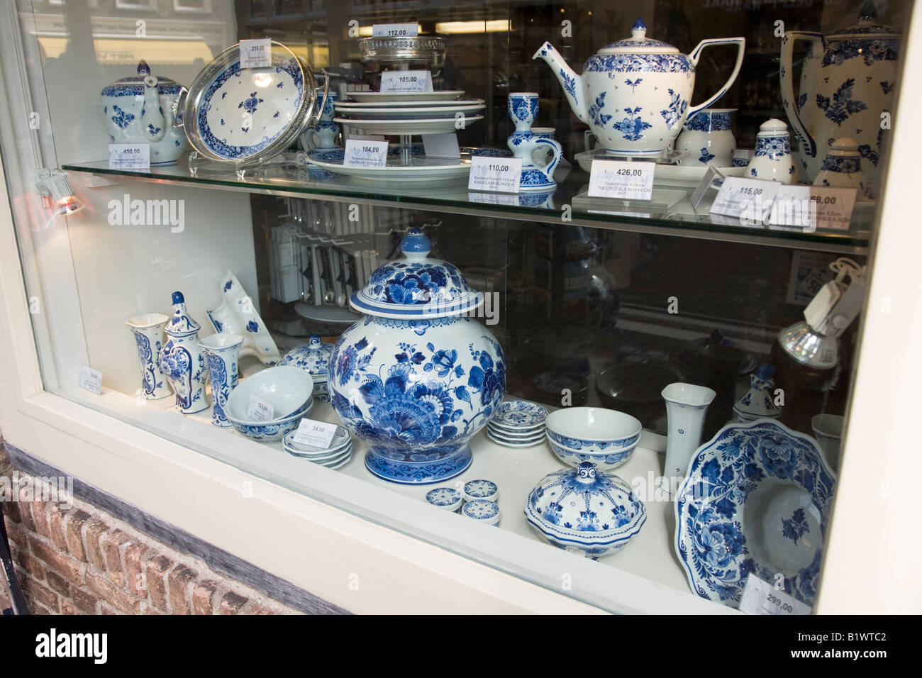 Royal Delftware pottery on display in a shop window in Delft. Netherlands. - Stock Image