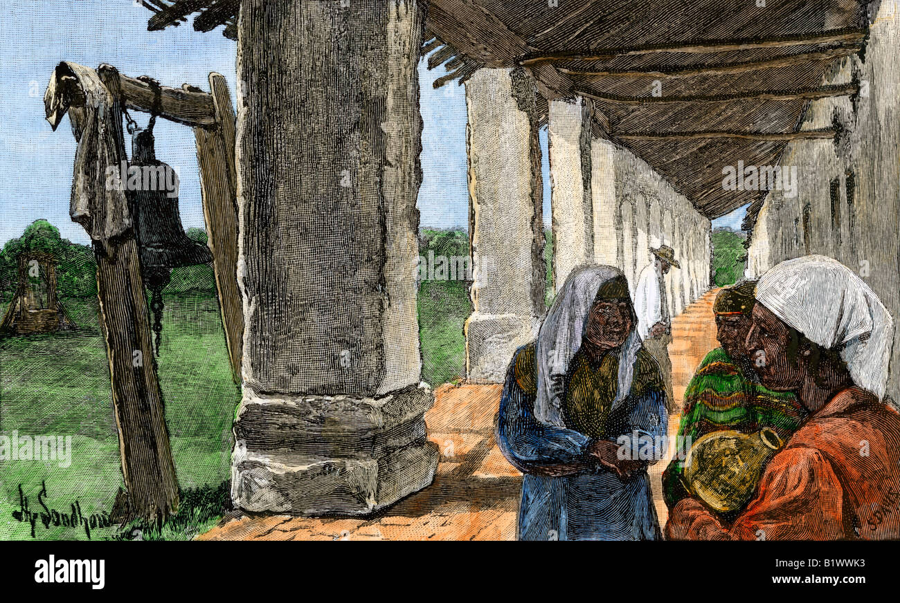 Native Americans at San Miguel Archangel Mission California 1800s. Hand-colored woodcut - Stock Image