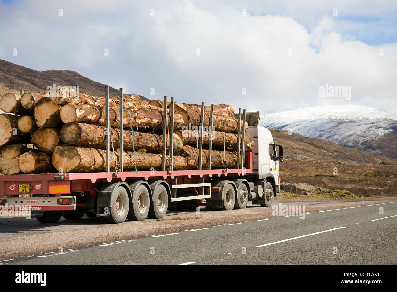 Glencoe, Glen Coe in the Lochaber  Scottish Highlands Scotland. A82 Countryside road logging transport, tree haulage, - Stock Image