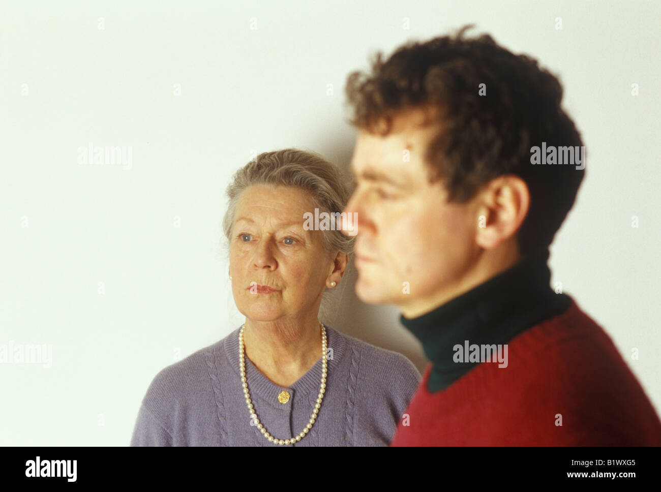 profiles of older woman and younger man - Stock Image