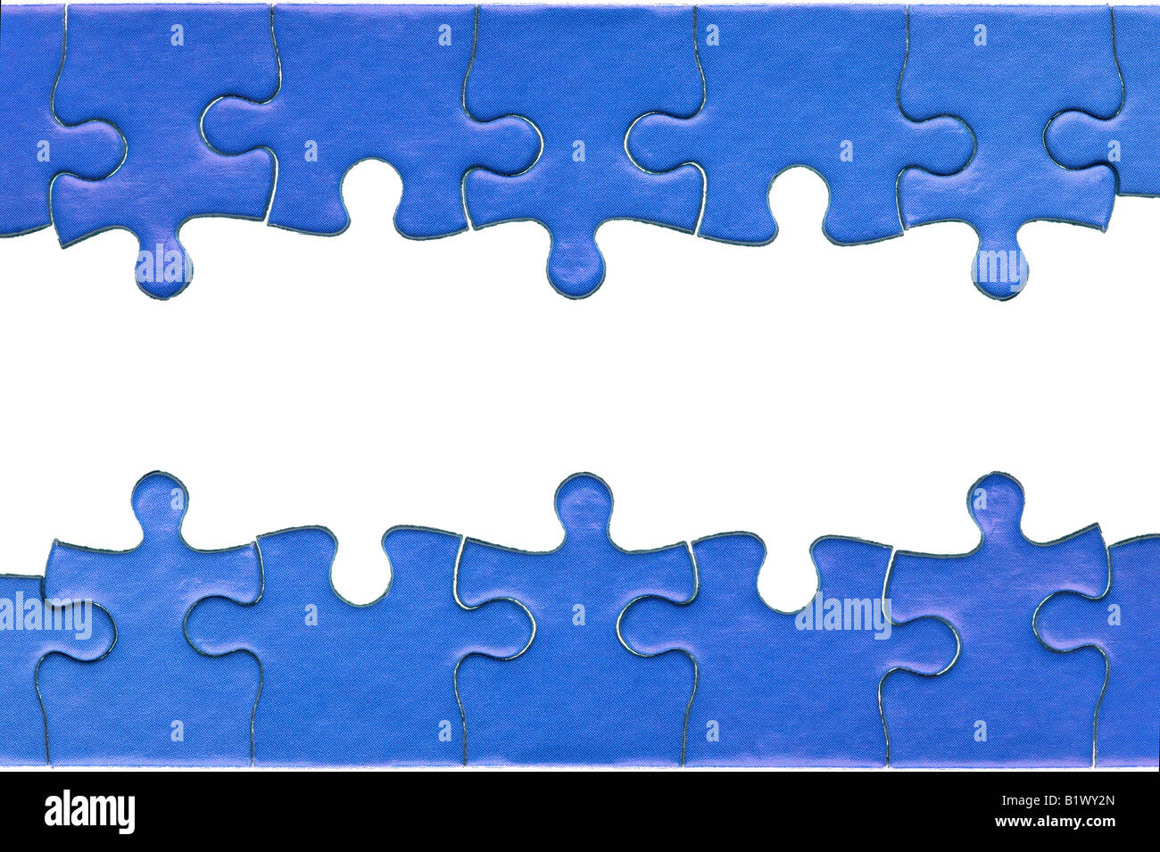 Pieces from a genuine blue jigsaw puzzle arranged to form a page header and footer isolated on a white background - Stock Image