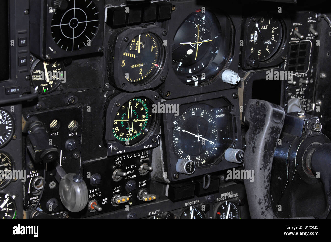 Airplane instrument panel showing pilot controls including navigation equipment, landing gear switch and control - Stock Image