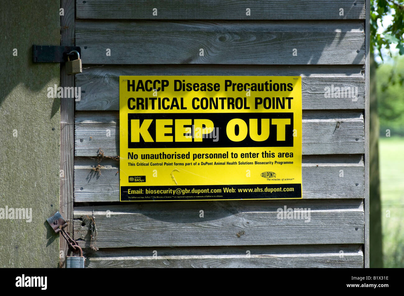 Keep Out disease control notice at farm entrance - Stock Image